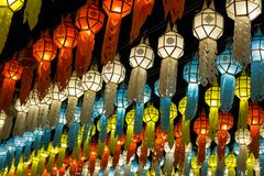 Colorful hanging lanterns lighting on night sky stock photography