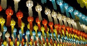 Colorful hanging lanterns lighting on night sky royalty free stock image