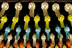 Colorful hanging lanterns lighting on night sky in loy krathong festival. At northern of thailand stock photo