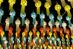Colorful hanging lanterns lighting on night sky in loy krathong festival. At northern of thailand stock photography