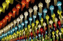 Colorful hanging lanterns lighting on night sky stock photography