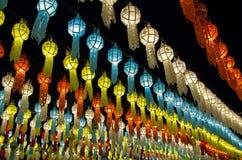 Colorful hanging lanterns lighting on night sky stock photos