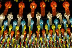 Colorful hanging lanterns lighting on night sky royalty free stock photo
