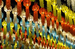 Colorful hanging lanterns lighting on night sky in loy krathong festival. At northern of thailand stock image