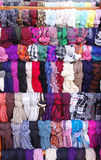 Colorful hanging scarves in shop Royalty Free Stock Images
