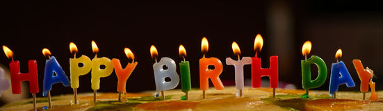 Colorful happy birthday candles Royalty Free Stock Image