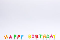 Colorful happy birthday candles on white background Stock Photography