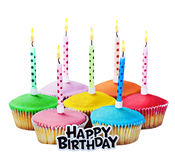 Colorful happy birthday cupcakes with candles Stock Photography