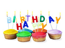 Colorful happy birthday cupcakes with candles Royalty Free Stock Image