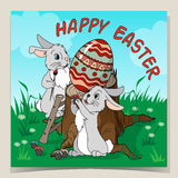 Colorful Happy Easter greeting card with bunny and eggs. Cute Happy Easter greeting card. Easter Bunny with Easter eggs.  Stock Image
