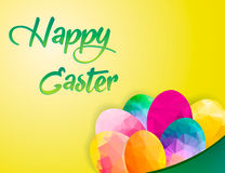 Colorful Happy Easter greeting card with composition of geometric polygonal eggs: green, red, blue. Yellow background. Green text. EPS10  illustration Royalty Free Stock Images
