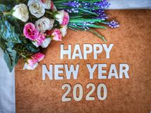 Happy New Year 2020 wishes with a vintage roses background. A colorful Happy New Year 2020 wishes with a vintage roses background royalty free stock photo
