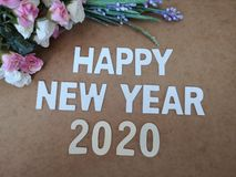Happy New Year 2020 wishes with a vintage roses background. A colorful Happy New Year 2020 wishes with a vintage roses background royalty free stock images