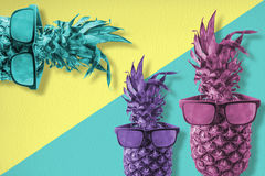Colorful happy pineapple fruit wearing sunglasses Royalty Free Stock Photos