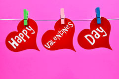 Colorful Happy Valentine's Day Hanging Hearts. A modern, bright and colorful message on three hanging red heart decorations wishing you a Happy Valentine's Day Stock Images
