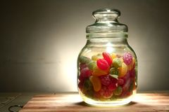 Colorful Hard candies in a jar Stock Images
