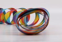 Colorful paper streamers in the studio. Colorful harlekin paper streamers lying in the studio royalty free stock image