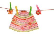 Colorful hat on a clothesline  on white Royalty Free Stock Image