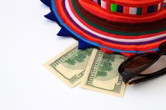 Colorful hat, 100 dollar bills on white background, isolate. Christmas and travel concept. stock photo