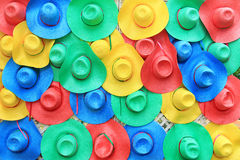 Colorful hats background stock photos