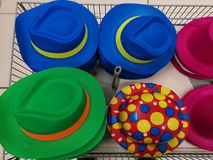 Colorful hats different designs in a basket. Design, colors and different sizes royalty free stock photos