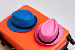 Colorful hats on modern suitcase. Royalty Free Stock Image