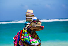 Colorful hats and scarves. Being carried by beach vendor in Punta Cana Royalty Free Stock Photography