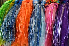Colorful head dresses on display. Head dresses displayed for sale in rainbow colors ready for celebration stock image