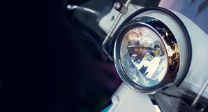 Colorful headlight of scooter on dark background Stock Image