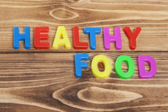 Colorful Healthy Food word on wooden background Royalty Free Stock Photos