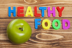 Colorful Healthy Food word on wooden background Stock Photo