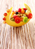 Colorful healthy fresh fruit salad in a boat Royalty Free Stock Image