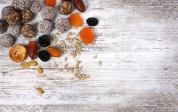 Colorful healthy homemade candies with nuts, dry fruits royalty free stock photography