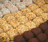 Colorful healthy homemade candies with nuts, dry fruits and spices Royalty Free Stock Photos