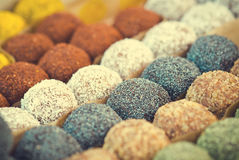 Colorful healthy homemade candies with nuts, dry fruits and spices Royalty Free Stock Images