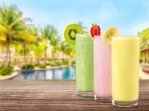 Colorful healthy milkshakes of different flovours. Green color red white background colorful isolated stock image