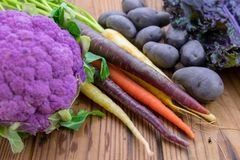 Colorful healthy purple vegetables. Fresh colorful healthy purple vegetables on a wood table Stock Images