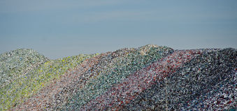 Colorful heaps of crashed glass at a recycle site Royalty Free Stock Image