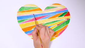 Colorful heart being drawn against white background. Timelapse. stock video