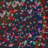 Colorful heart bokeh motion on smooth dark background Stock Image