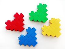 Colorful heart built toy blocks on white background royalty free stock images