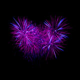 Colorful heart fireworks on the black sky Stock Image