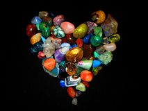 Colorful heart of gemstones royalty free stock photos