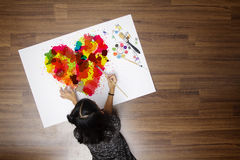 Colorful heart with girl painting brush watercolor. Top view creative photo on wooden floor in her room at home royalty free stock photography