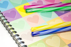 Colorful heart graphic cover notebook, diary with colorful pen Royalty Free Stock Photo