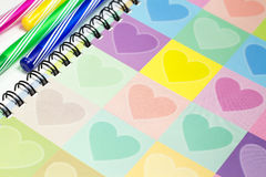 Colorful heart graphic cover notebook, diary with colorful pen Royalty Free Stock Images