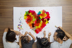 Colorful heart with happy family lying painting brush watercolor Royalty Free Stock Image