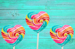 Colorful heart lollipop on vintage color wood Stock Image