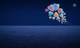Colorful heart love balloon float on fantasy sky and moon Stock Photo