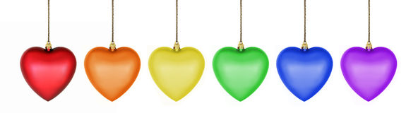 Colorful Heart Ornaments. A rainbow row of colorful heart ornaments Stock Photography